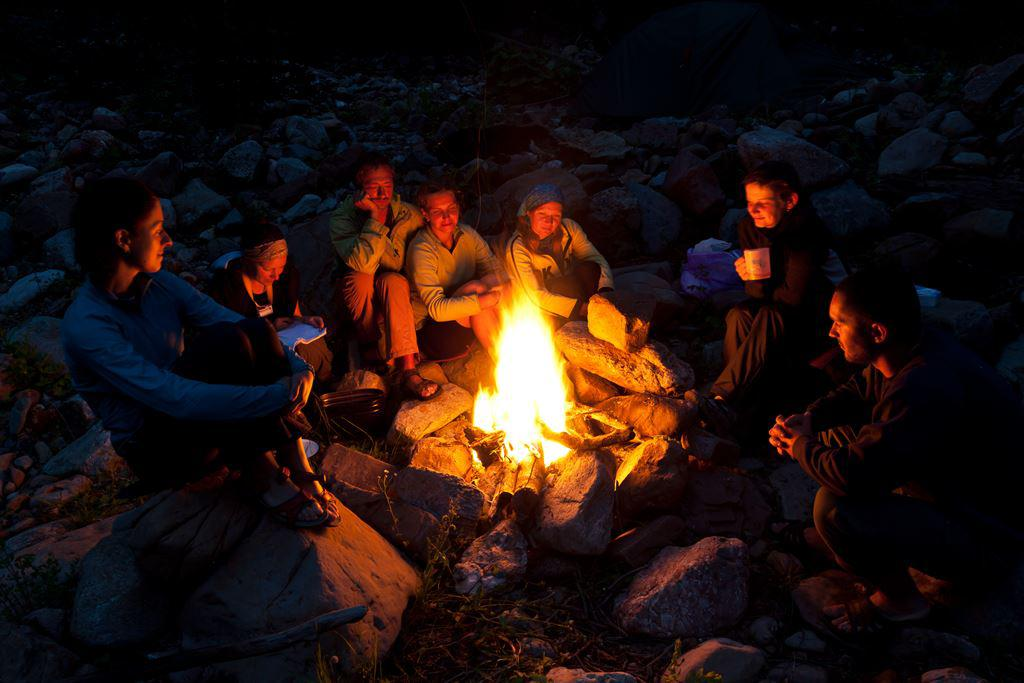 Group enjoying camp fire